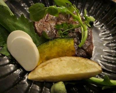 Steak with turnip, pumpkin, potato and watercress