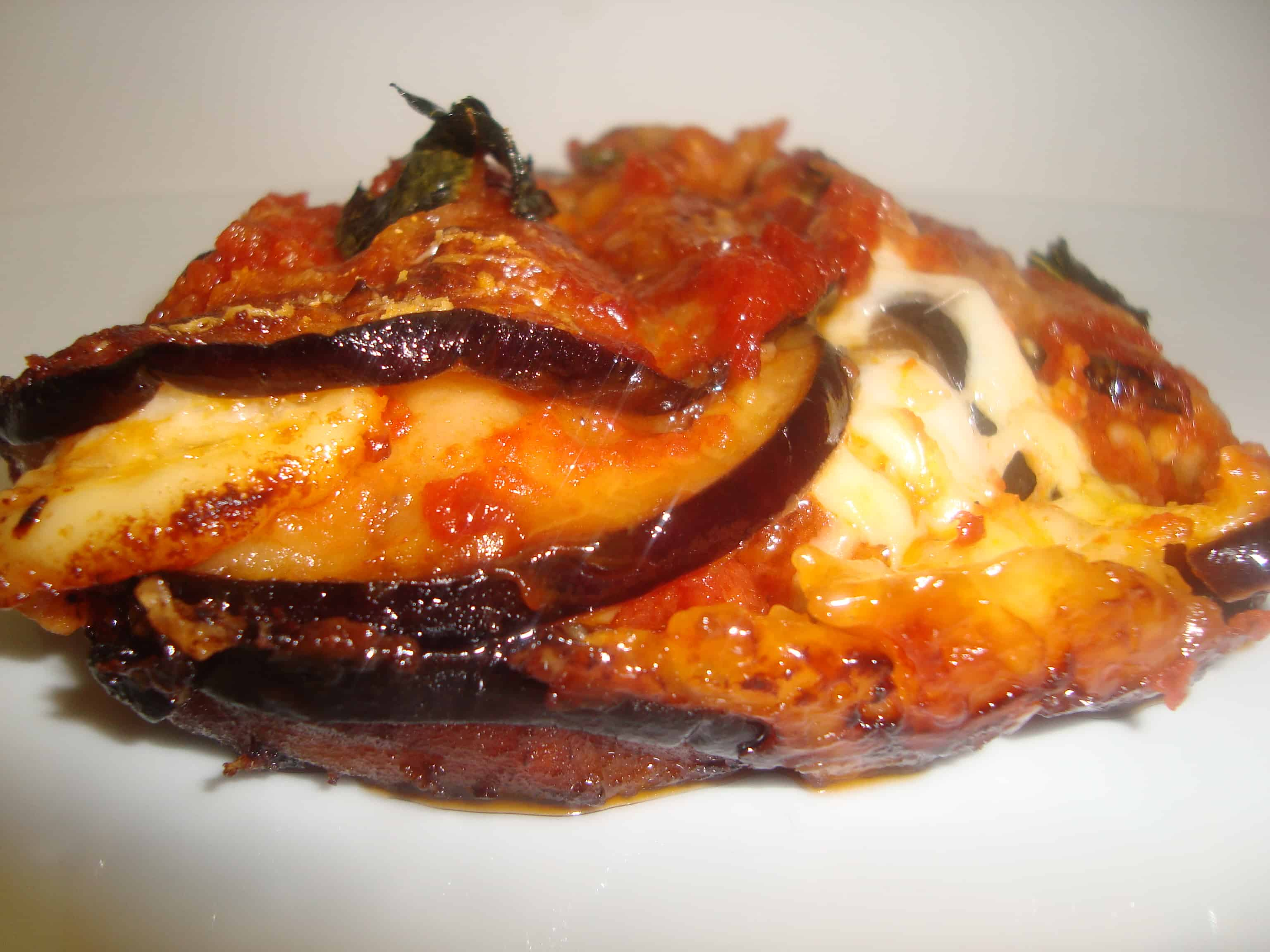 This is a Southern Italian dish. Melanzane means aubergine (eggplant ...