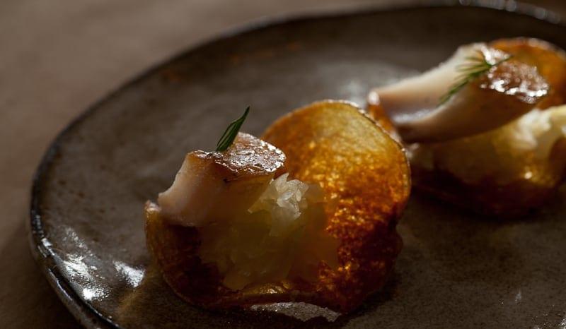 Potato chip with sauerkraut and smoked cod