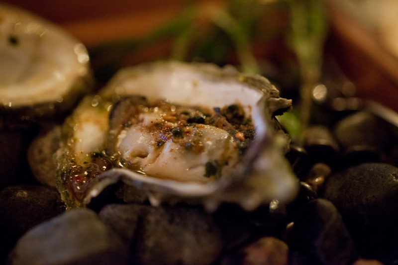 Grilled oyster with tequila and sage