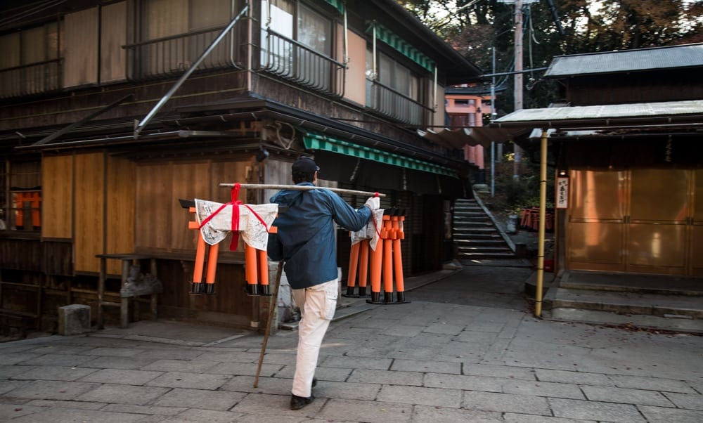 Fushimi Inari Shrine maintenance worker with torii gates