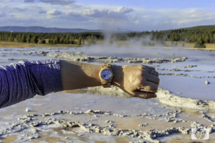 Andi at Great Fountain Geyser in Yellowstone with her Jord Wood Watch