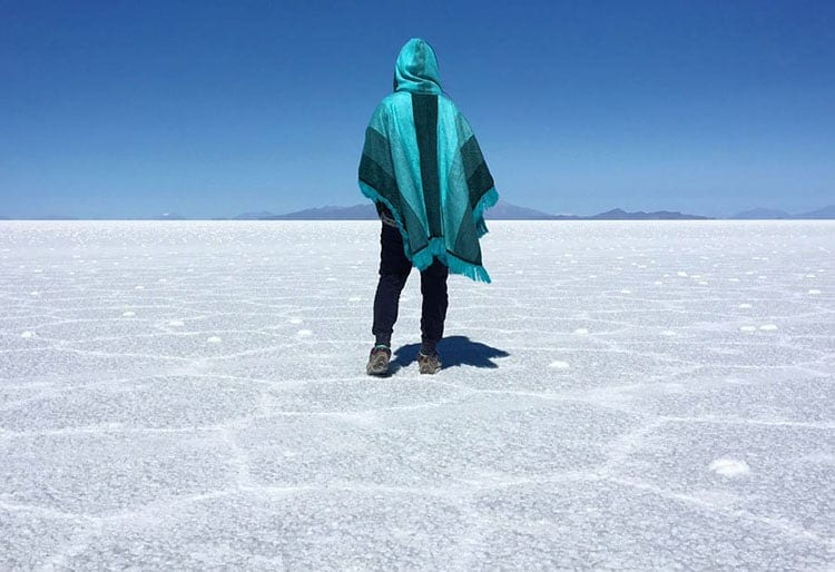 Traveler Tuesday - Jaclynn of The Occasional Traveller - Bolivia-Uyuni-Salt-Flats-Back-Poncho