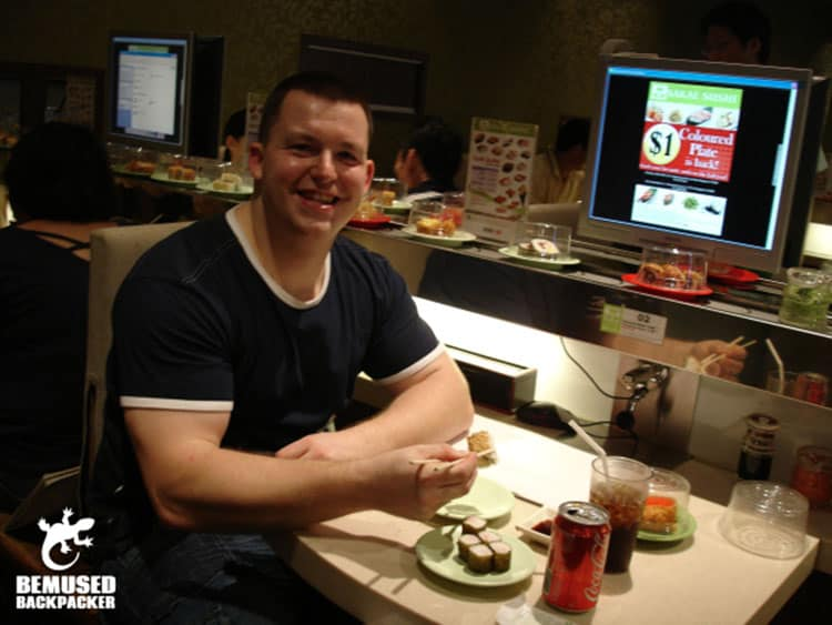 Traveler Tuesday - Michael of Bemused Backpacker_michael-huxley-eating-sushi-in-singapore