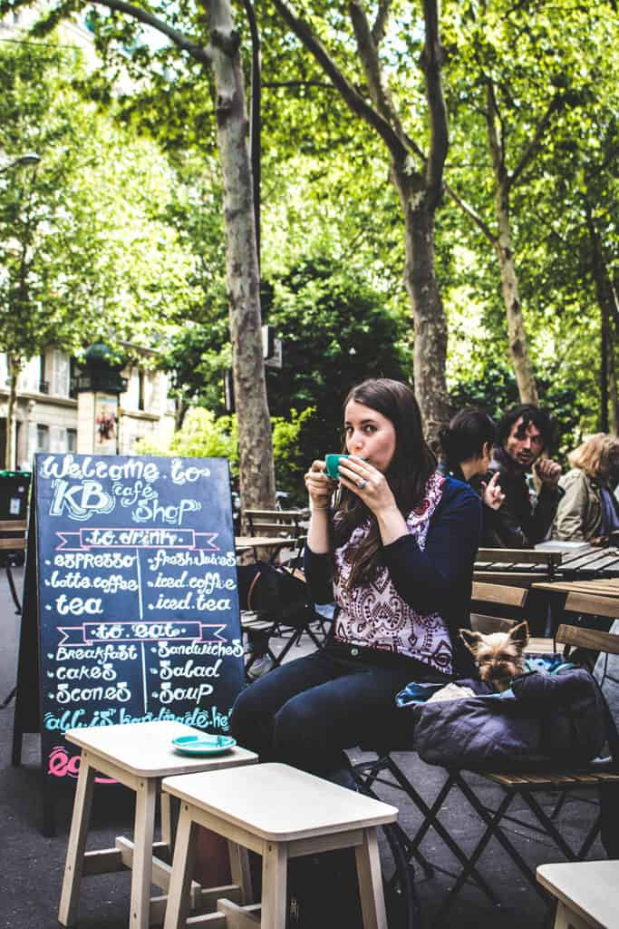 Alix having coffee in Paris
