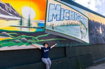 Andi at Michigan Mural in Grand Rapids hero_Photo credit- Emily Sierra