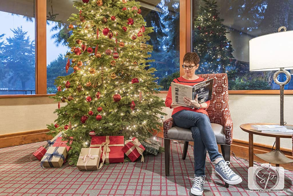 Andi in Salishan Resort Library_Francophile Library Winter Edition hero