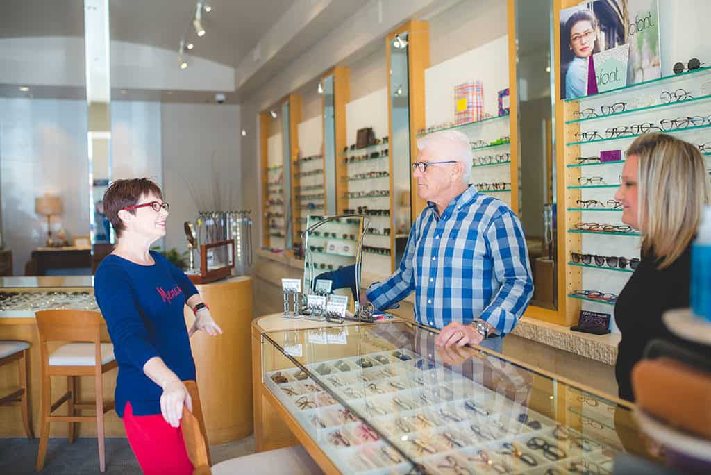 Andi discussing Lafont glasses in the Village Eyeworks Store in Phoenix