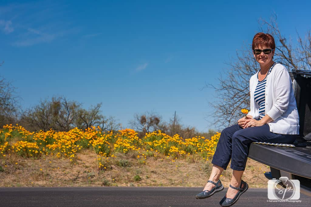 Andi amongst the Poppies at Santa Catalina State Park in Arizona in her Jambu Cherry Blossom Shoes in Navy