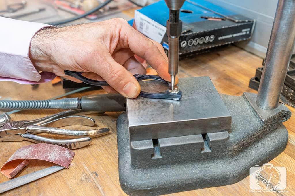 Preparing a pair of frames in the workshop in the Lafont Paris Atelier in Paris