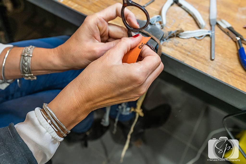 Sanding a pair of frames in the workshop in the Lafont Paris Atelier in Paris