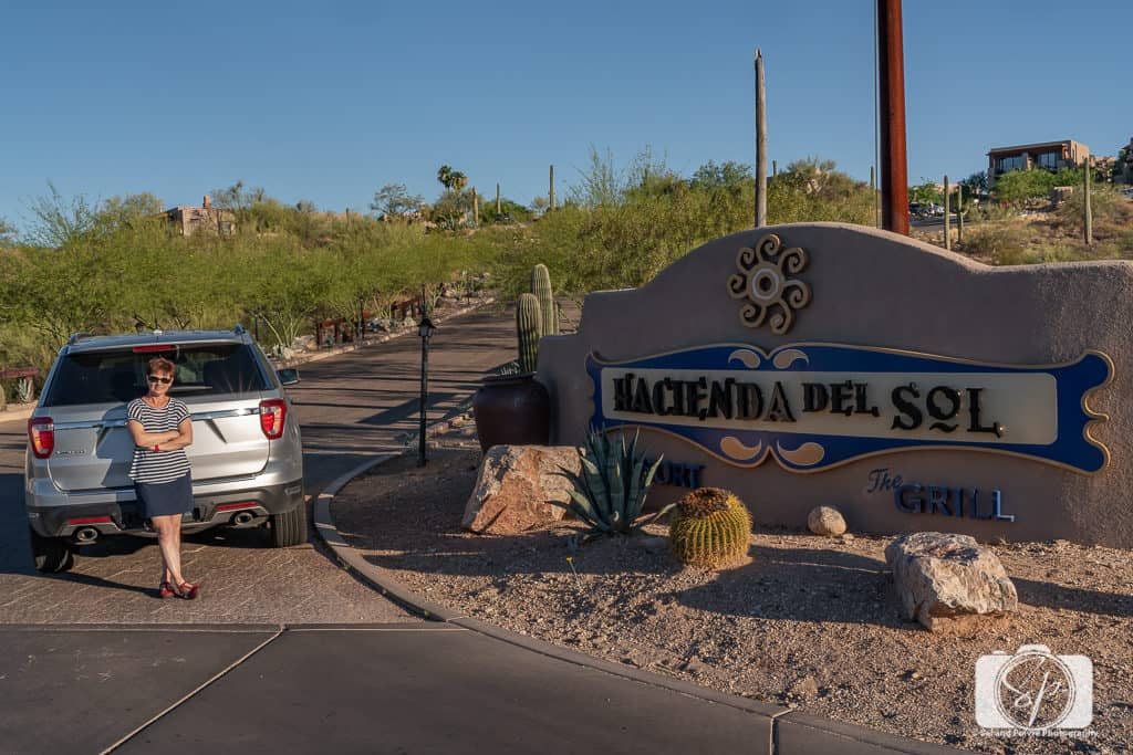 Andi in front of Hacienda del Sol sign in Tucson