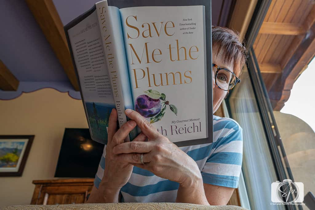 Andi with Save Me the Plums Book