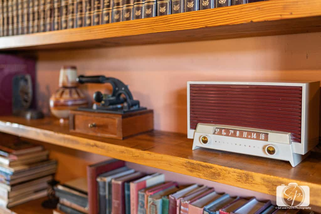 Radio on the library shelf at Hacienda del Sol