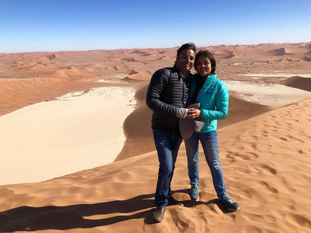 Traveler Tuesday – Jyoti of Story At Every Corner_The experience of climbing Big Daddy in Namibia and looking down to Dead Vlei (behind us), is for ever etched as a special experience in my heart
