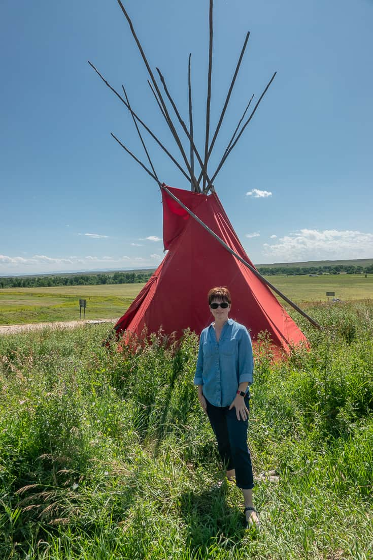 Andi in front of the Teepees in front of the Last Stand Trading Post outside of Little Big Horn in Montana
