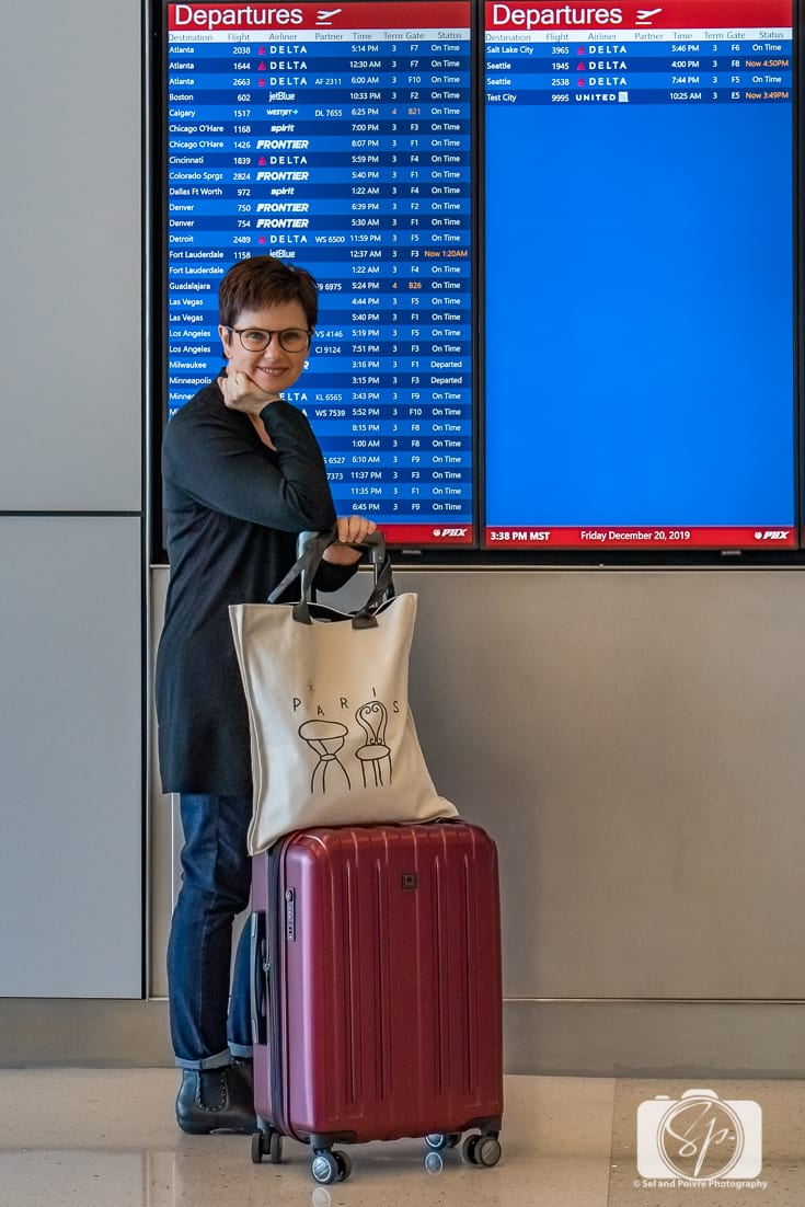 Andi with her Delsey Paris Helium Titanium hardside luggage set carry at the Departures panel