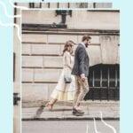 couple walking on Parisian street holding hands