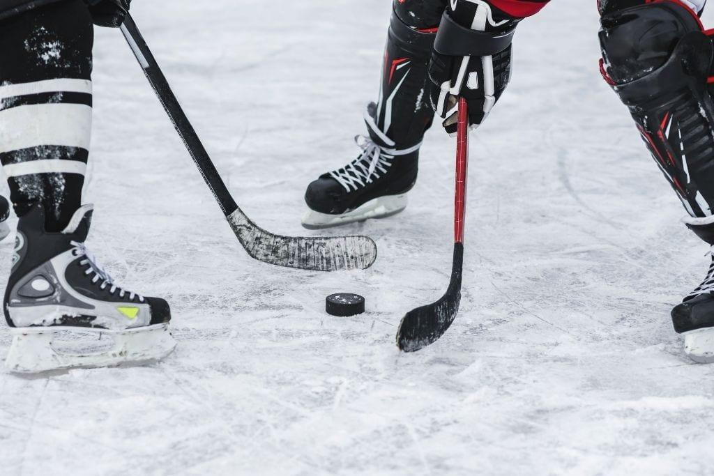 photo of 2 people playing ice hockey