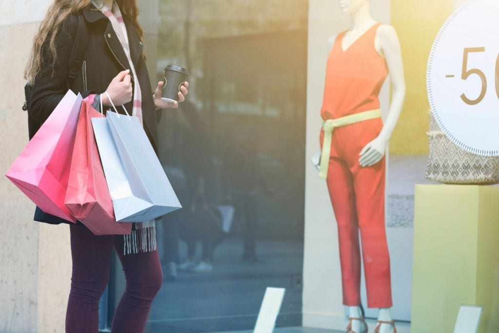photo of a girl window shopping in paris