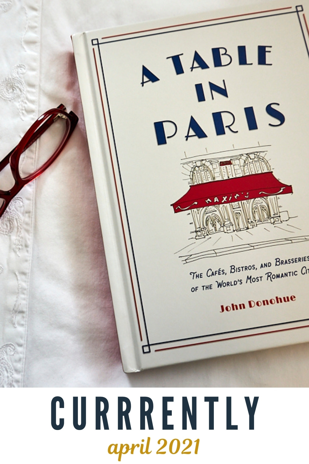A Table in Paris book on bed with glasses