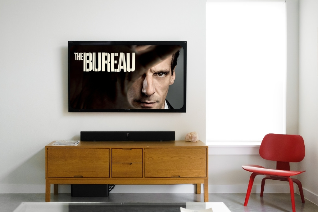 living room tv with the bureau on the screen