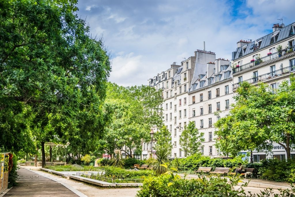spring garden in paris with buildings