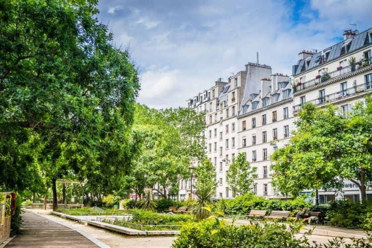 spring garden in paris with buildings