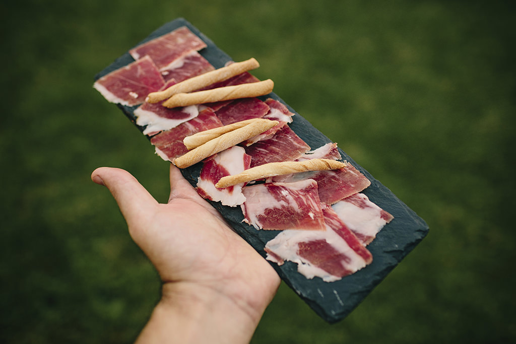 Person holding sliced of meat