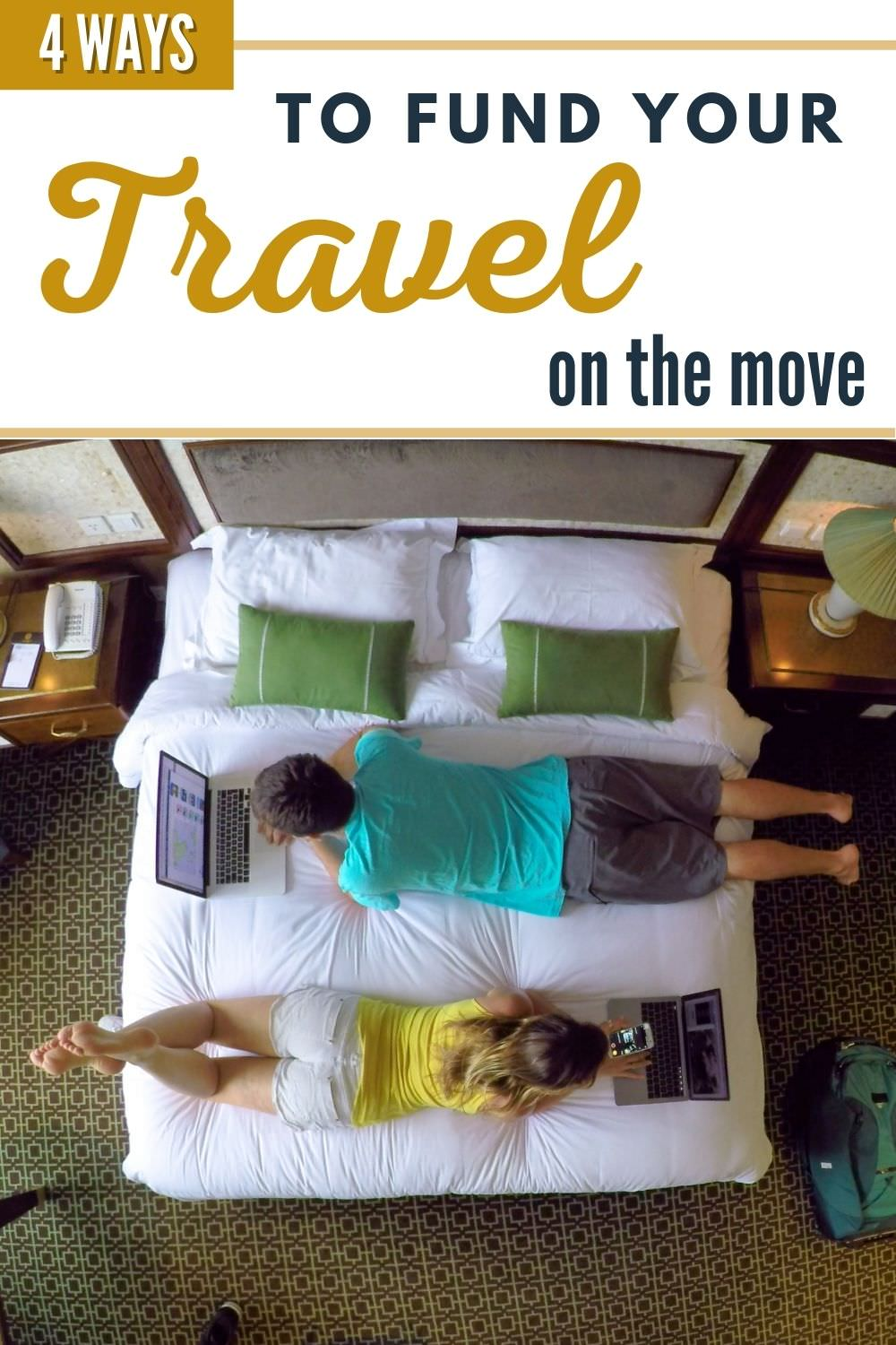 couple working on hotel bed