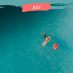 couple on rafts in turquoise ocean