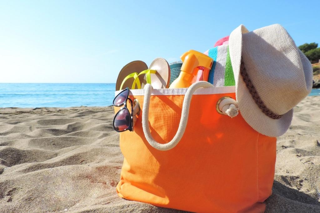 loaded beach bag on the sand