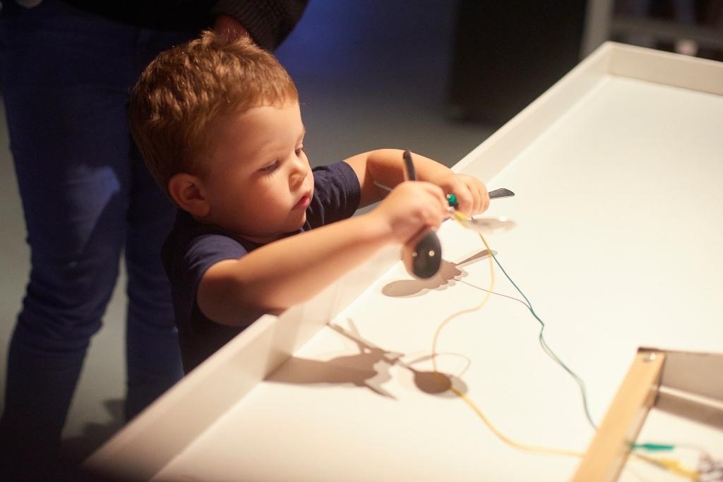child with museum exhibit