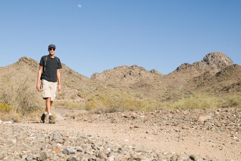 man hiking in deset