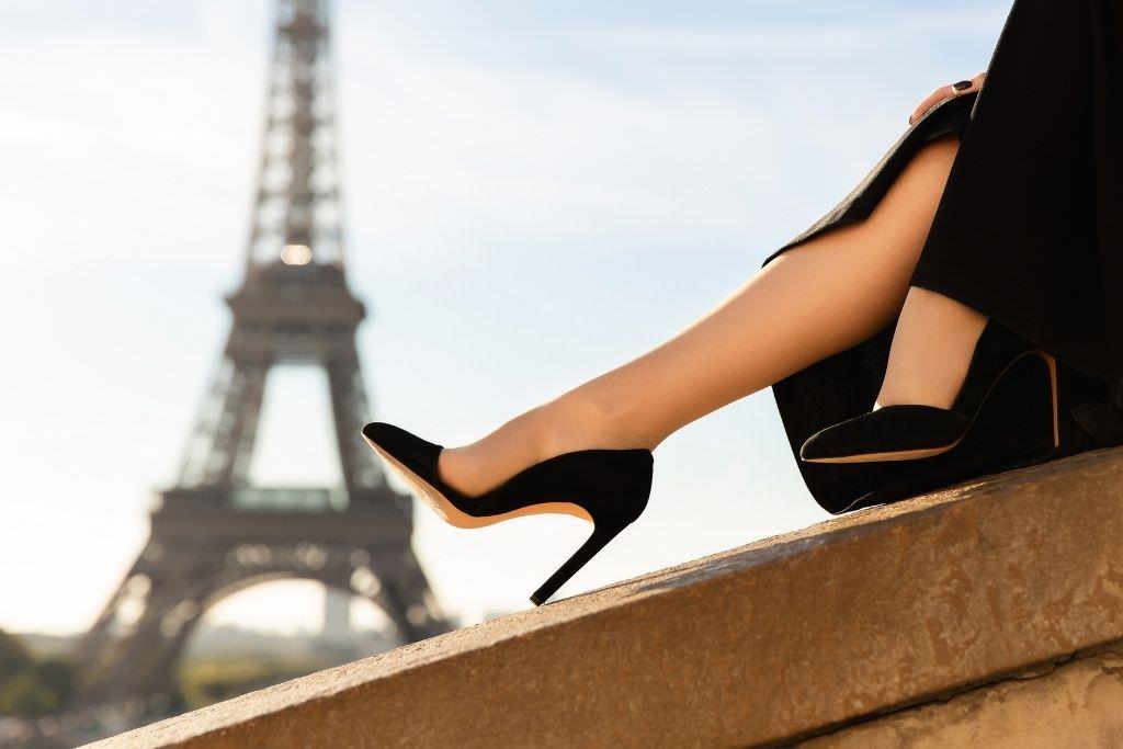 women wearing black heel with eiffel tower in the background