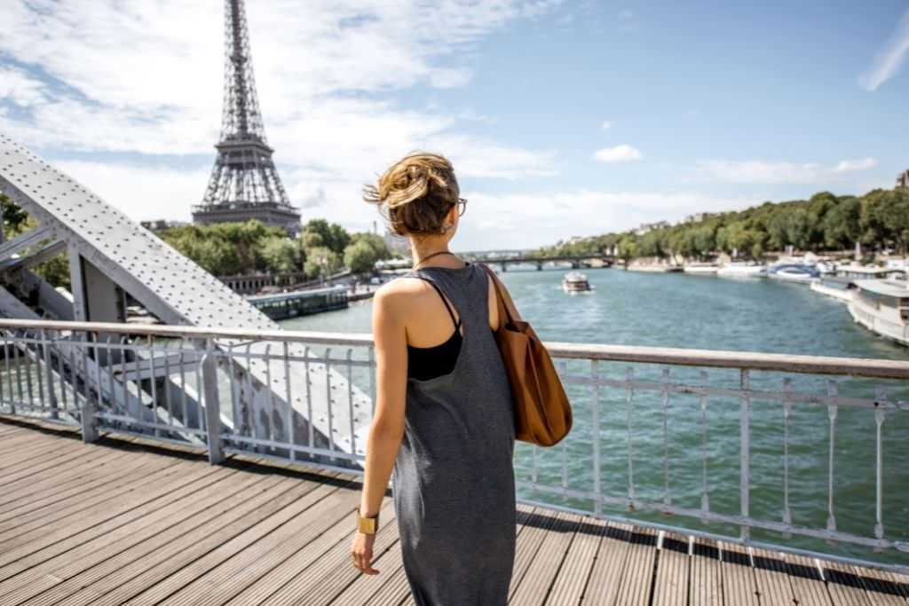 girl walking on bridge in Paris