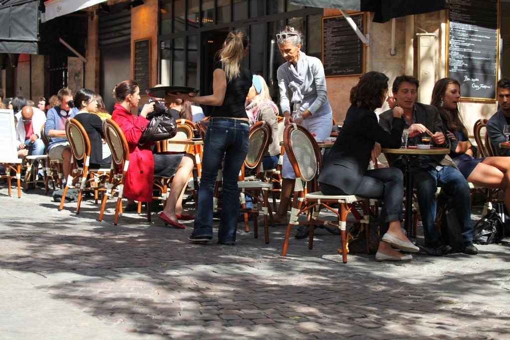 people at cafe in paris