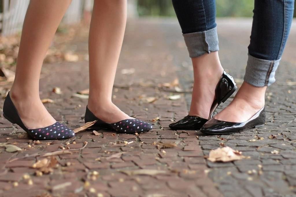 2 set of girls feet wearing ballet flats