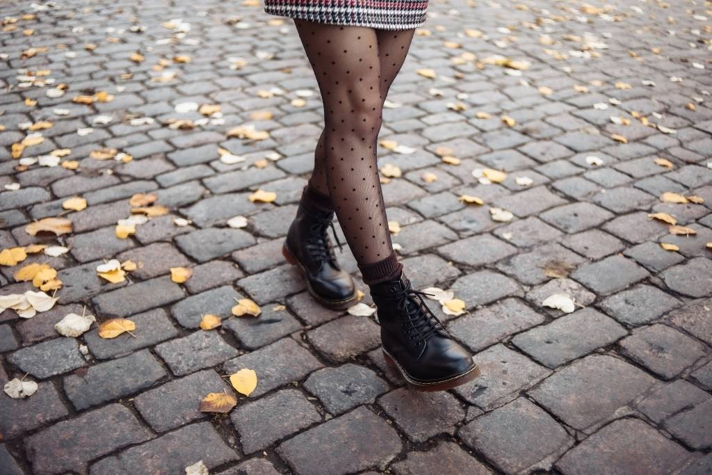 girl in black tights and combat boots