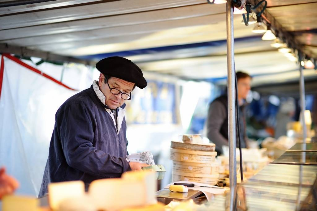 man at Cheese Stand at French Market