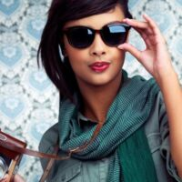 women in sunglasses with camera