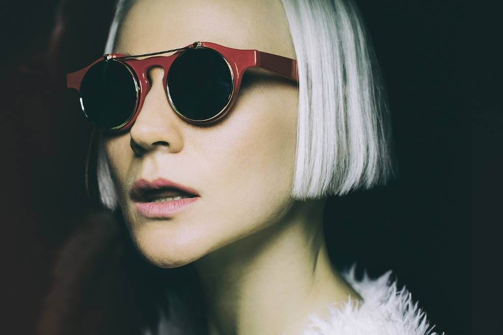 woman in red glasses