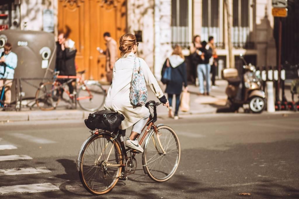 woman biking in Paris