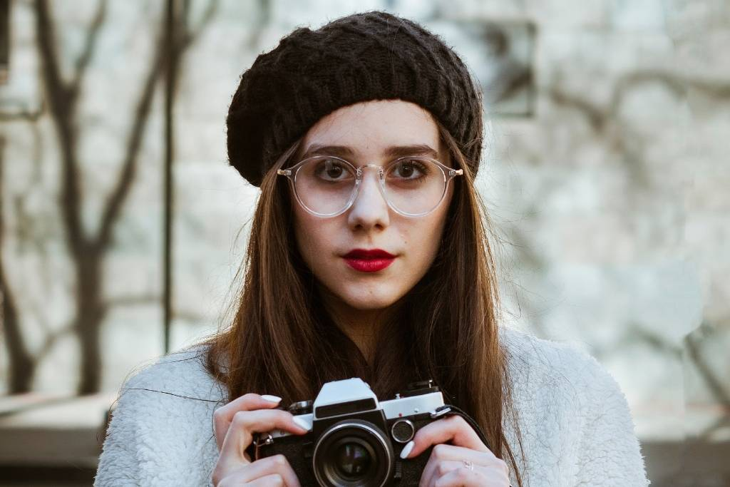 french girl with beret and camera
